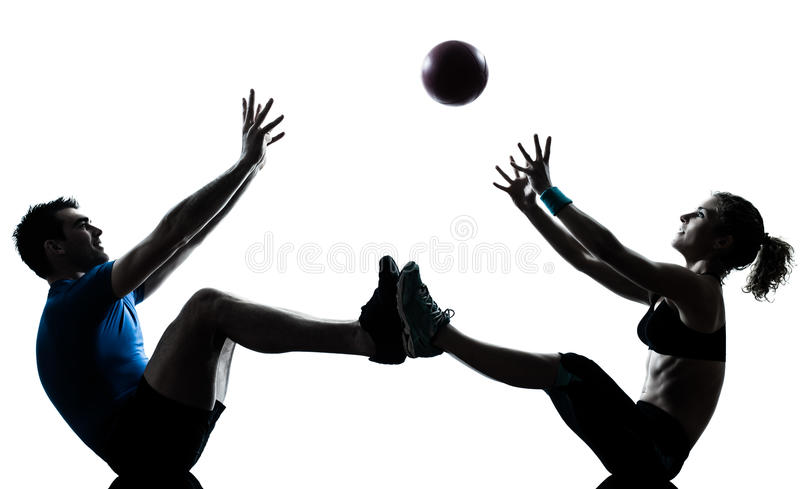 Man woman exercising workout tossing fitness ball stock photo