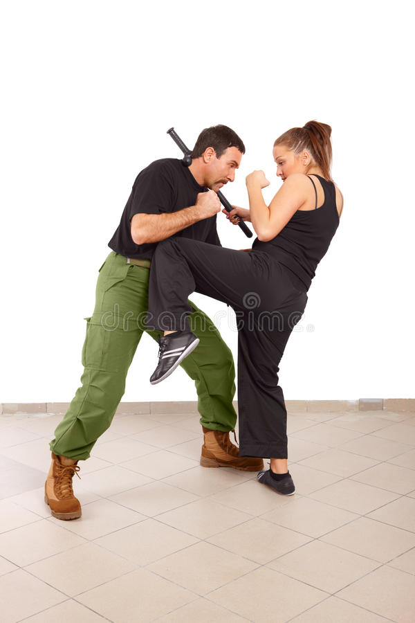 Man And Woman Fight With Truncheon Royalty Free Stock Photos