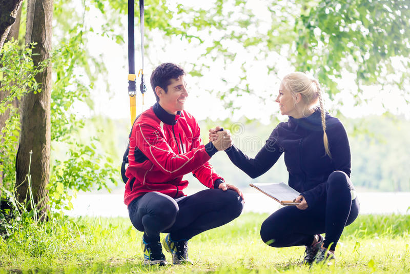 Man and woman at fitness training stock photography