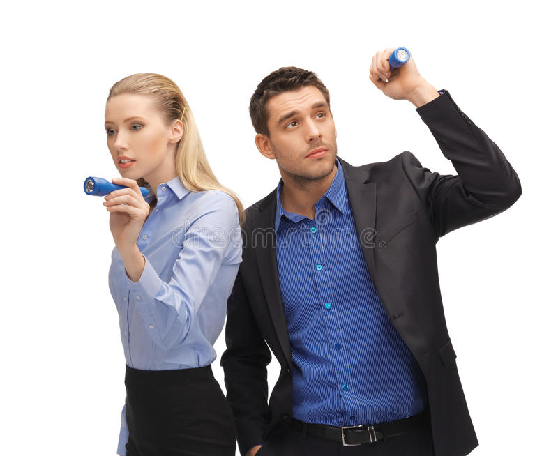 Man and woman with flashlights royalty free stock photos