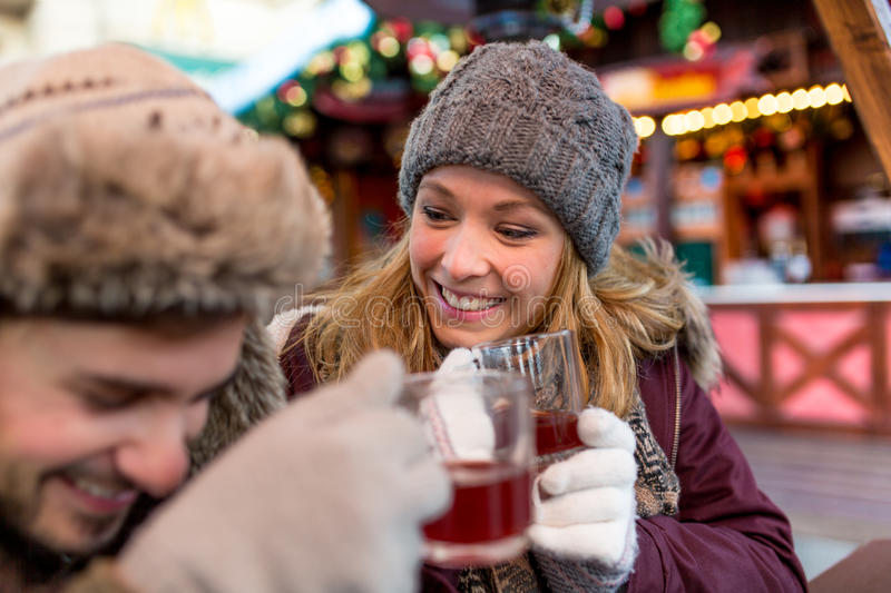 Man and Woman flirt on the Christmas Market. Its a german tradition that people meet on the christmas market in the days before christmas and enjoy their time stock photography
