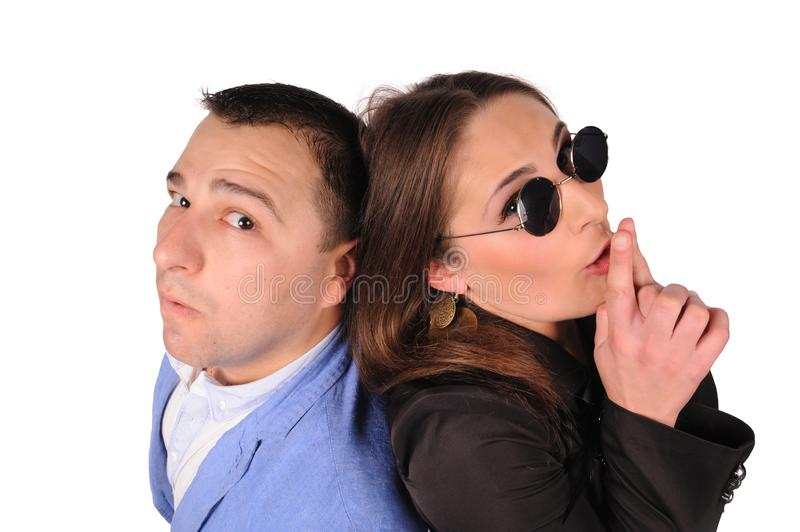 Man and woman with funny faces isolated over white background stock photo