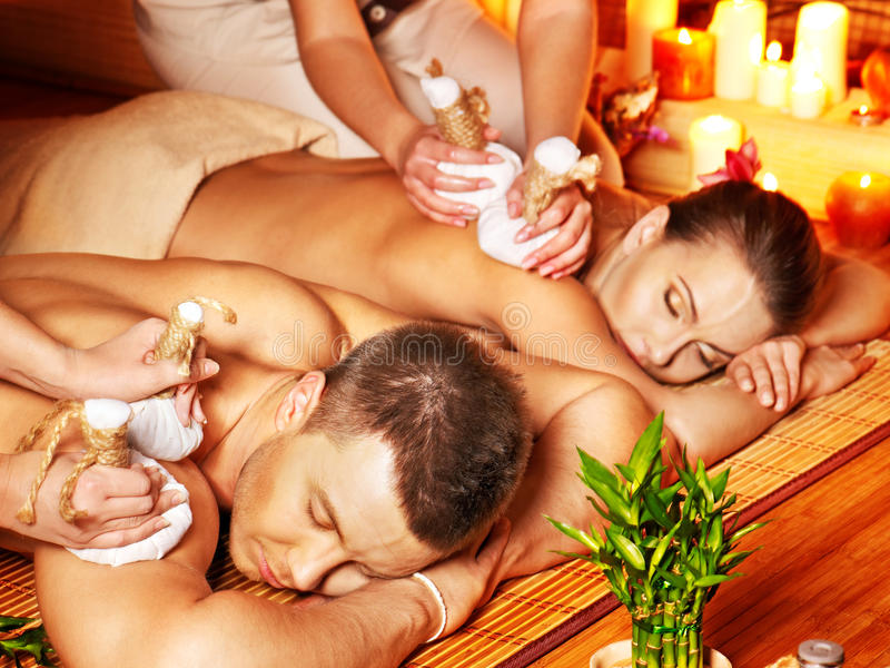 Download Man And Woman Getting Herbal Ball Massage In Spa. Stock Photos - Image: 27442263