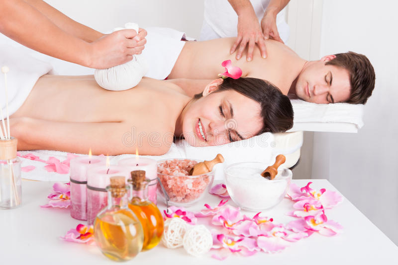 Man and woman getting massage stock images