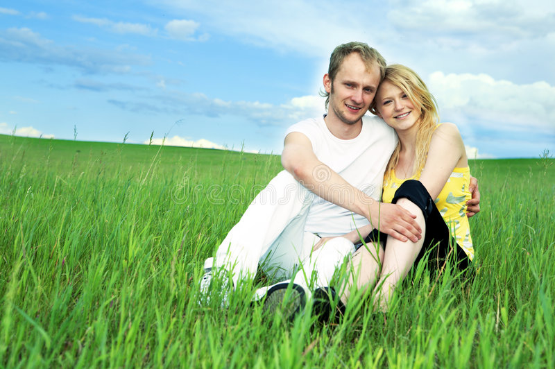 Man And Woman In Green Field Royalty Free Stock Photo