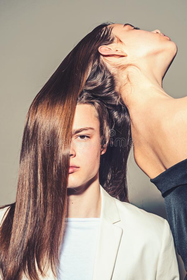Man and woman. Hair style and skincare. Fashion couple in love. Friendship relations. Family bonds. Beauty and fashion. Long beautiful and healthy hair. shaved stock photography