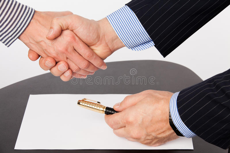 Man and woman hand shaking. Man and woman ready to seal a deal stock photography