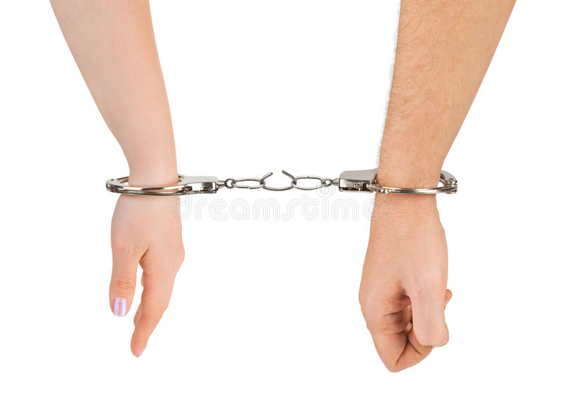 Man and woman hands and breaking handcuffs