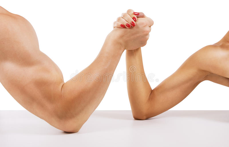 A man and woman with hands clasped arm wrestling. Isolated on white royalty free stock photos