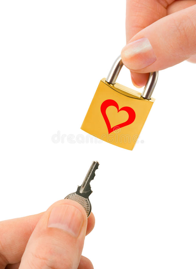 Man and woman hands with key and lock stock photos