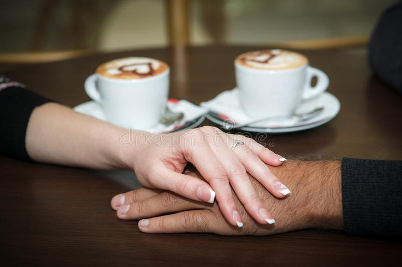Man and woman hands royalty free stock photos