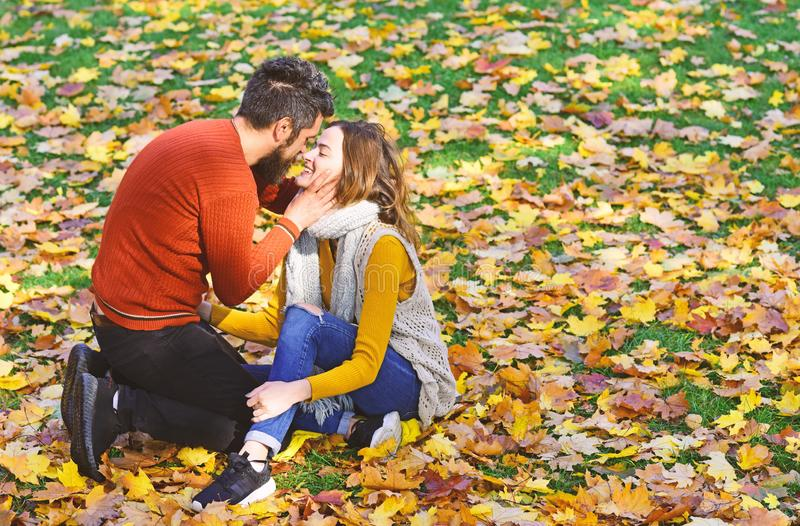 Man and woman with happy faces on autumn trees background stock image