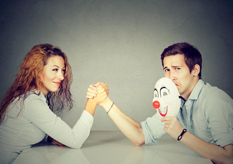 Man and woman having arm wrestling. Woman and men having competition in arm wrestling fighting for gender rights stock image