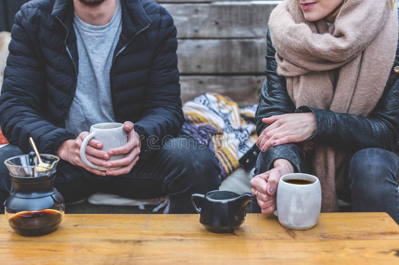 Man and woman having coffee outdoors royalty free stock photography