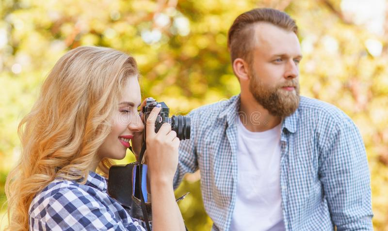 Man and woman having date outdoor. Girl wit a photo camera and her boyfriend. stock image