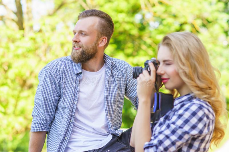 Man and woman having date outdoor. Girl wit a photo camera and her boyfriend. stock photo