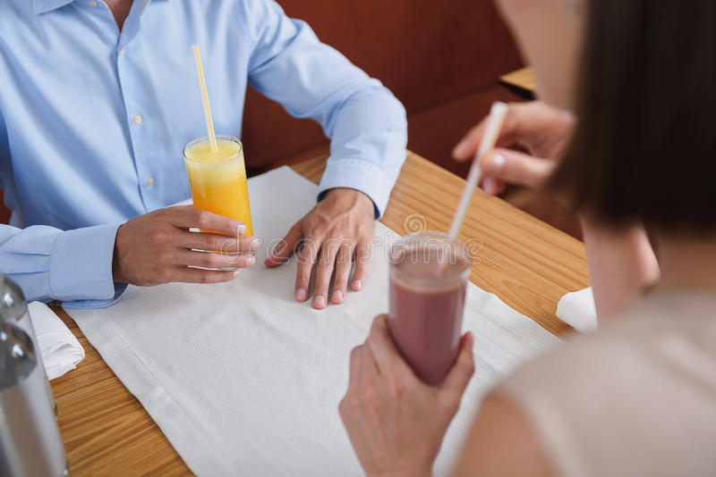 Man and woman having lunch at cafe royalty free stock photo