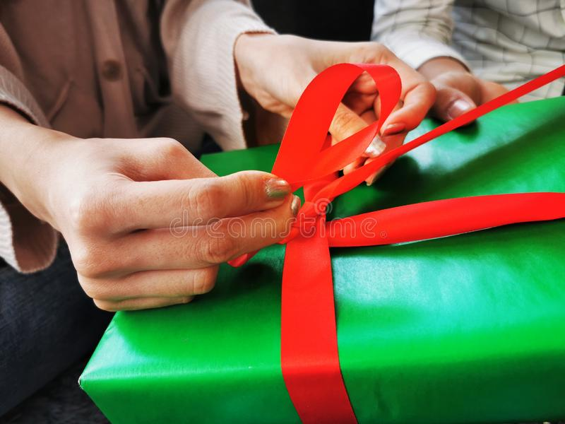 Man and Woman helping gift​ box​ wrapping for Christmas New Year stock photography