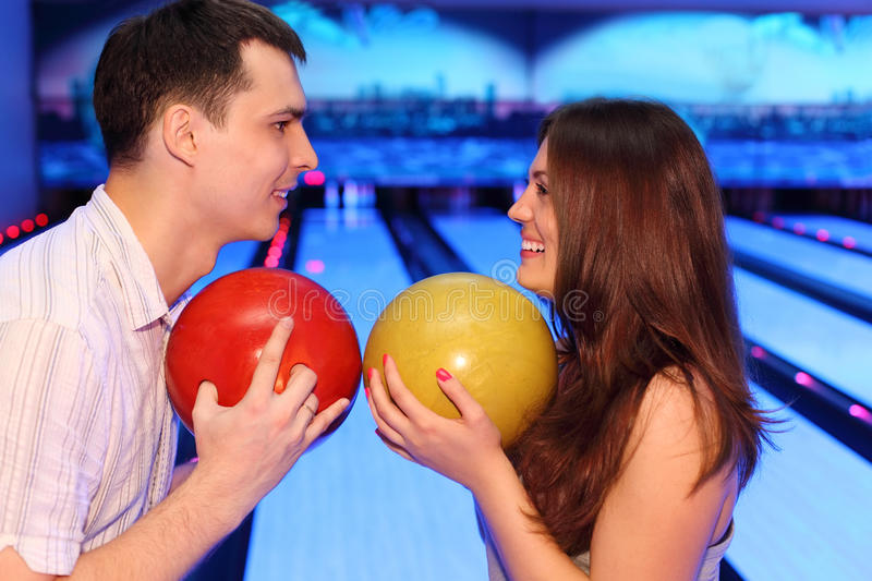 Download Man And Woman Hold Balls In Bowling Royalty Free Stock Images - Image: 25150379