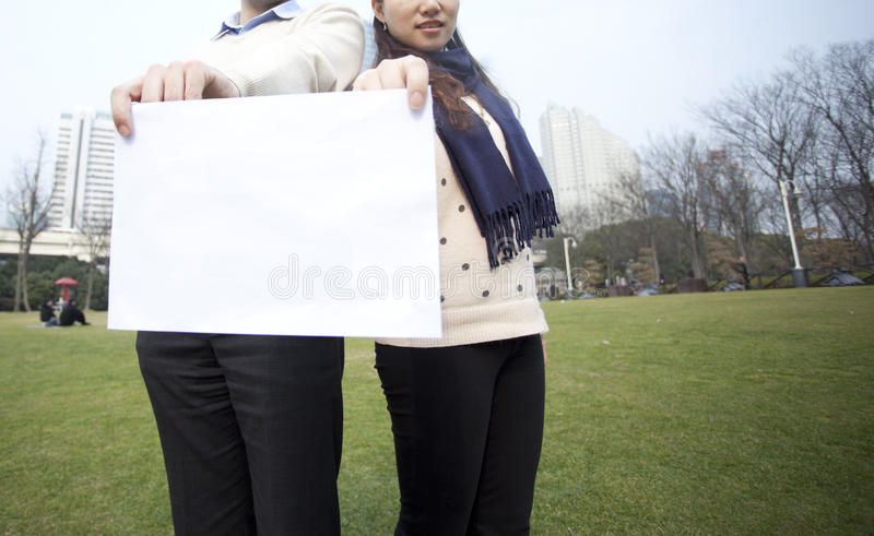 Man And Women Holding Blank Paper Stock Photos
