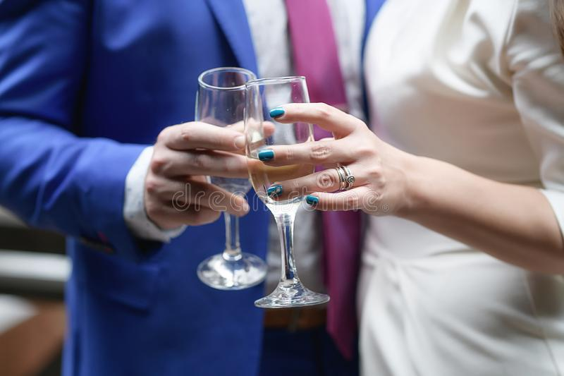 Man and a woman holding champagne flutes and toasting stock photography