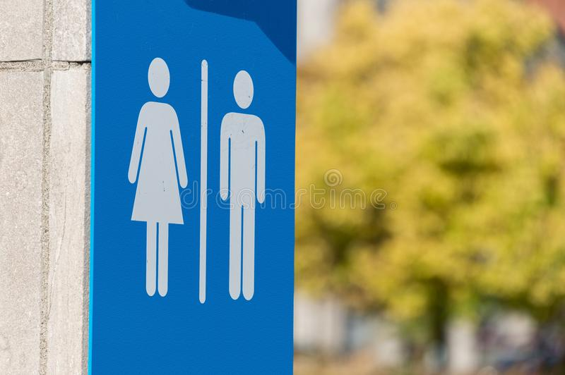 Man and woman icons, toilet sign. In Montreal with autumn foliage in background stock photography