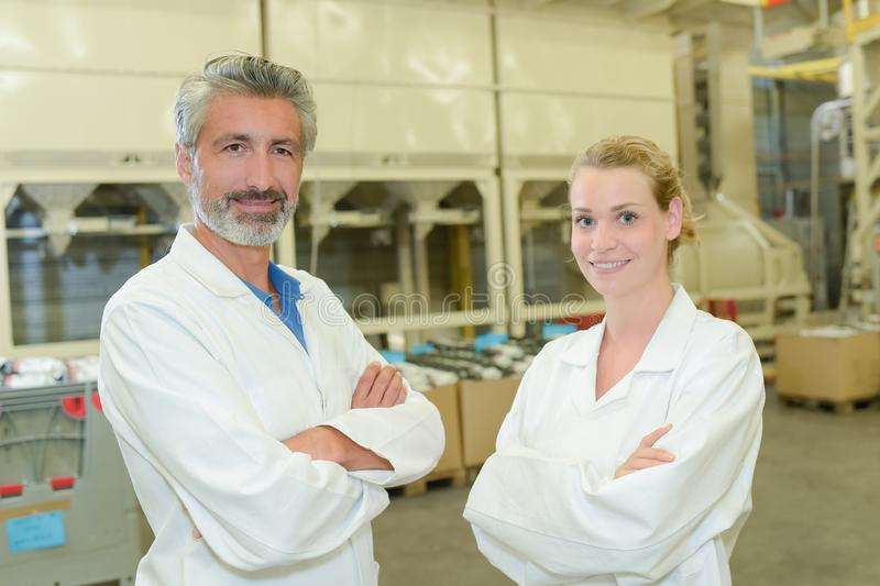 Man and woman - industrial science royalty free stock photography