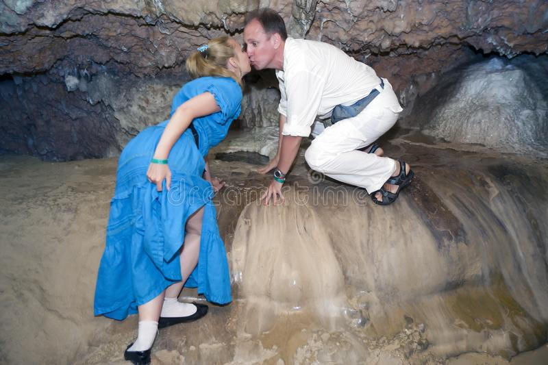 Man and woman kiss in a special place for lovers in a Bellamar cave. Matanzas, Cuba stock photography