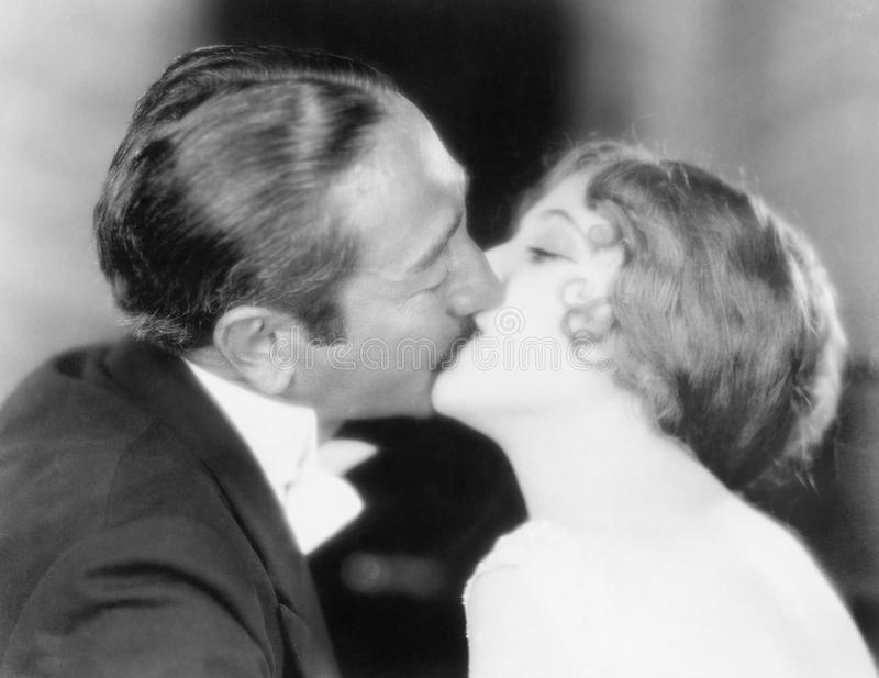 Man and woman kissing each other. (All persons depicted are no longer living and no estate exists. Supplier grants that there will be no model release issues stock photos