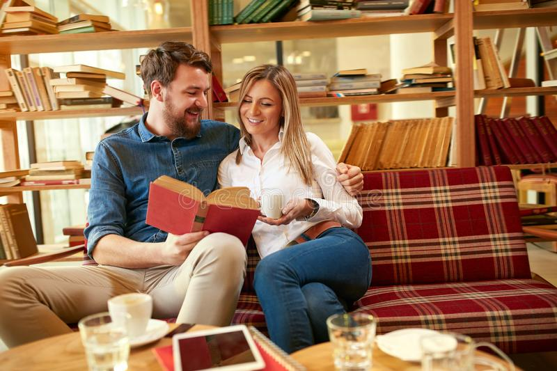 Man and woman learn together stock images