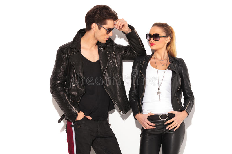 587f7a51957 Man and woman in leather jackets looking at each other. Men and women in  leather