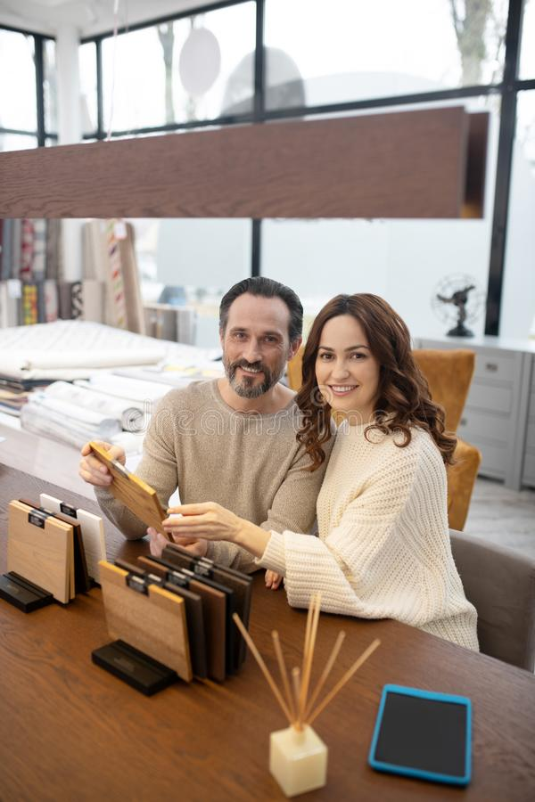 Man and woman in light sweaters looking happy royalty free stock photography