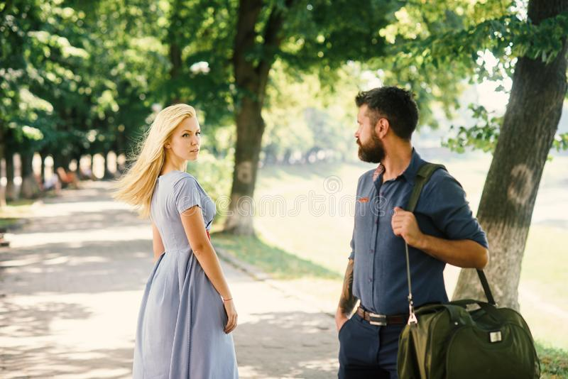 Man and woman likes each other. Man with beard. Man and women likes each other. Man with beard and blonde girl stopped to get acquainted. Casual encounter, meet stock photo
