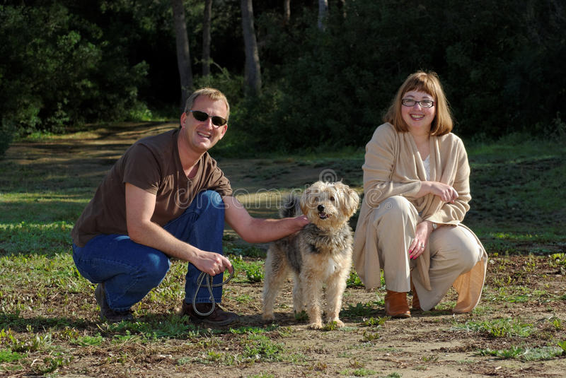 Man and Woman with Little Dog. stock photo stock images