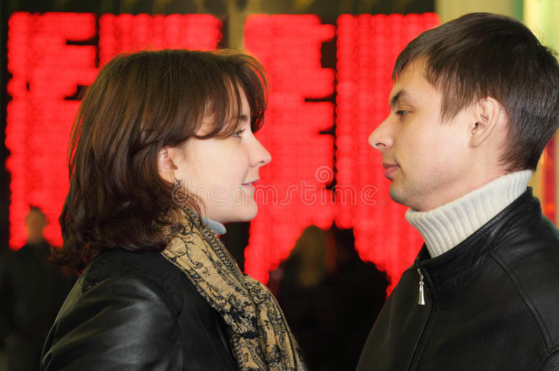 Man and woman look to each other stock image