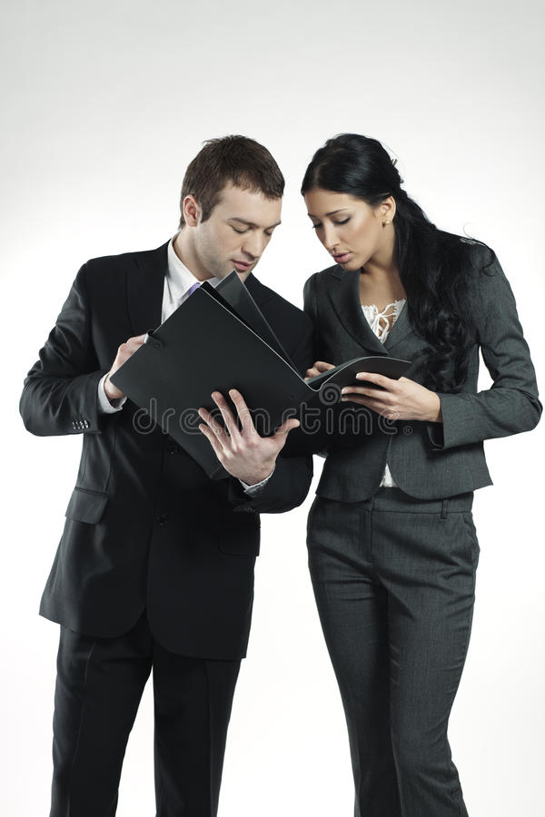 Man and woman looking at business portfolio royalty free stock images