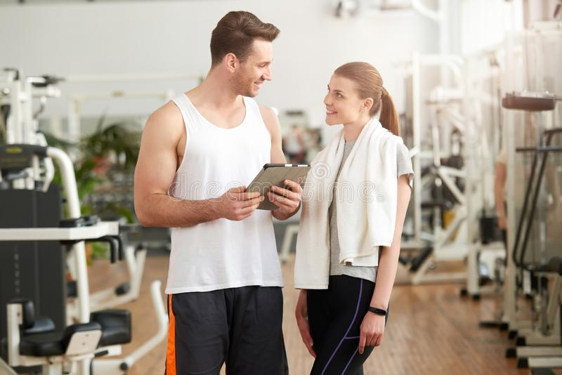 Man and woman looking at each other in gym. royalty free stock photo