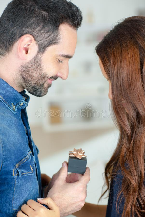 Man and woman looking at giftwrapped ringbox royalty free stock photography