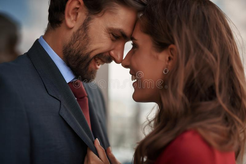 Man and woman looking with love to each other. Concept of romantic meeting. Close up portrait of happy smiling beloved lady looking with love to her male lover stock images
