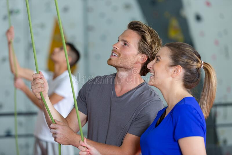 Man and woman looking at rope for wall climbing royalty free stock image