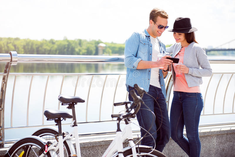 Man and woman looking at smartphone royalty free stock image