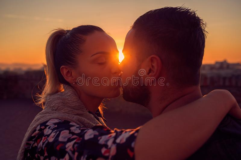 Man and woman in love kissing at evening  in sunset royalty free stock images