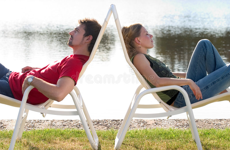 Man and woman lying. Man and woman lying back to back royalty free stock photos