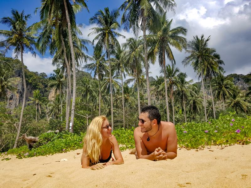 Man and Woman Lying on Sand royalty free stock image