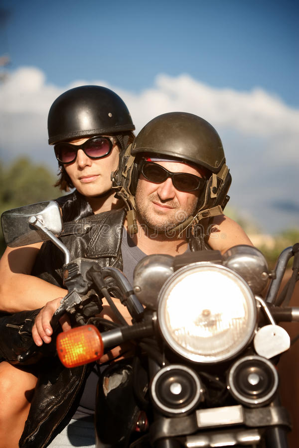 Man and Woman on Motorcycle stock images