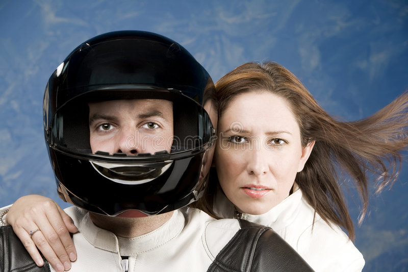 Man and woman on a motorcycle royalty free stock photography