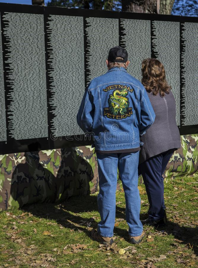 A man and woman at the Moving Wall for Vietnam War royalty free stock images