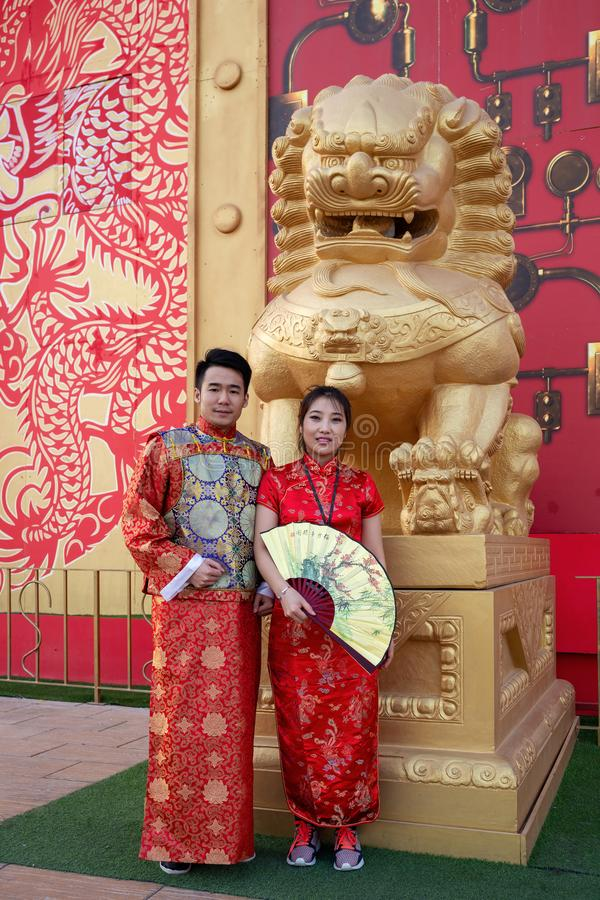 Man and woman in national costume in the pavilion of China in Global Village, Dubai stock images