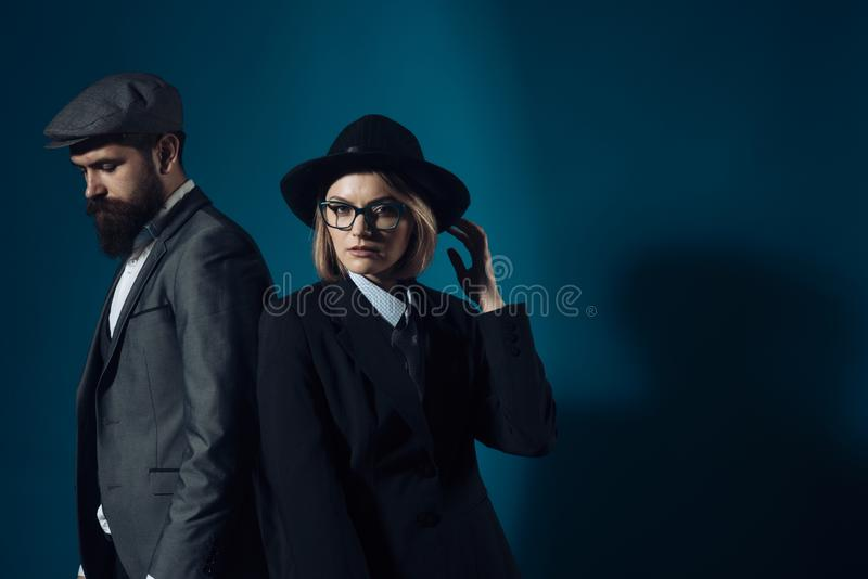 Man and woman in oldfashioned suit and hat stock image