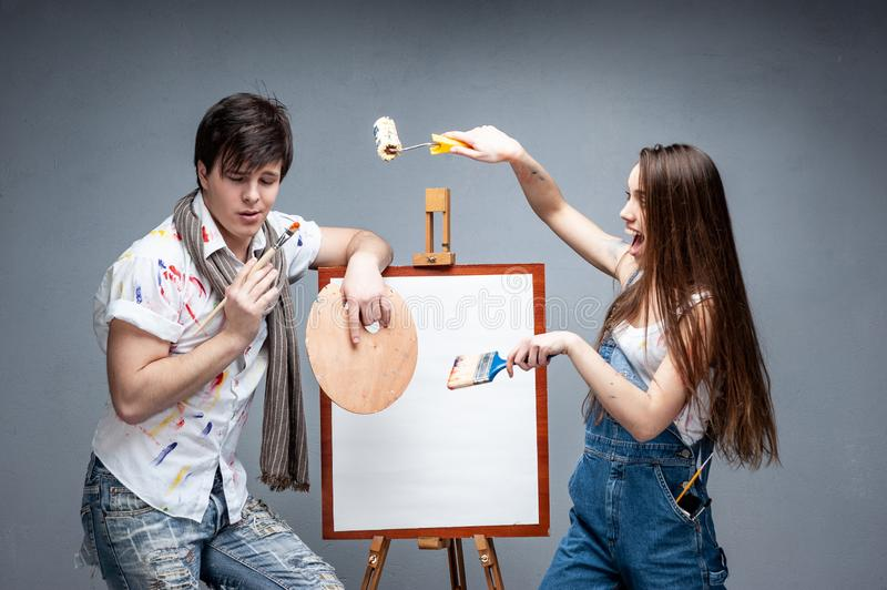 Man and woman painters discussing art project stock image